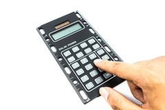 Handcounting on Calculator. On a White Background Stock Photos