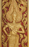 Handcraf thai style golden Deva carving . Stock Images
