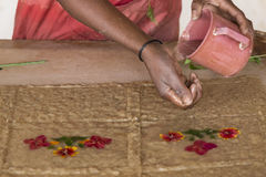 Handcraft artisan working on a flower decoration brown wet paper Royalty Free Stock Images