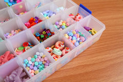 Handcraft colorful flower, alphabet and animal  bead in box. Stock Images