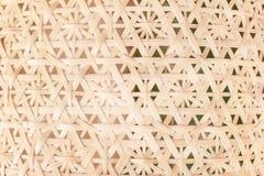 Handcraft den Bambus, der in der Blumenmuster-Beschaffenheitszusammenfassung für Hintergrund gesponnen wird stockfotografie