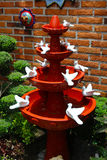 Handcraft fountain made of clay with many white doves Royalty Free Stock Photos