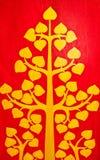 Handcraft la pittura con dorato sul backgro rosso Fotografia Stock Libera da Diritti