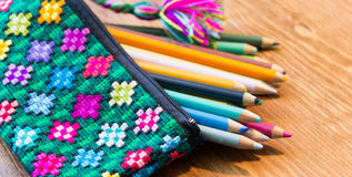 Handcraft pencil case and colors photograph. Photograph of a handcraft pencil case and colors photograph Royalty Free Stock Photo