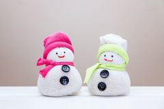 Handcraft toy snowmen made from socks and rice. Stock Photos