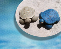 Handcraft Turtle. Pair of handmade turtle with oriental background Royalty Free Stock Photo