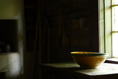 Handcrafted bowl in ancient kitchen Royalty Free Stock Image