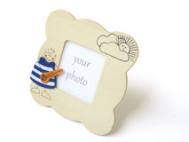 Handcrafted children wooden photo frame Royalty Free Stock Photo