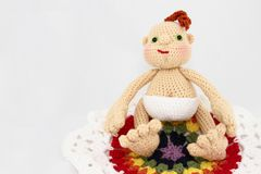 HandCrafted Crochet Baby Doll On Colorful Blanket Royalty Free Stock Photos