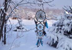 Free Handcrafted Dream Catcher With Owl Decoration And Copy Space Against Snow Lanscape. Royalty Free Stock Image - 185321676