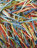 A Rainbow of Colorful Strands of Ribbons and Threads. A handcrafted fabric which creates a rainbow of colorful ribbons on woven fabric Stock Images