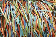 A Rainbow of Colorful Strands of Ribbons and Threads. A handcrafted fabric which creates a rainbow of colorful ribbons on woven fabric Stock Photos