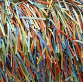 A Rainbow of Colorful Strands of Ribbons and Threads. A handcrafted fabric which creates a rainbow of colorful ribbons on woven fabric Royalty Free Stock Photo
