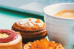Handcrafted fruit tarts and pastries with coffee Stock Photography