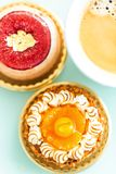 Handcrafted fruit tarts and pastries with coffee Royalty Free Stock Photos