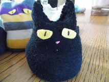 Handcrafted Hand Warmer or Beanbag. Photograph of handmade little kitty handwarmer or beanbag. Toy is made from discarded and re-purposed socks. Cat is full of Stock Images