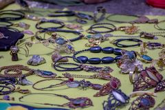 Handcrafted jewelery on a mat royalty free stock photo
