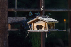 Handcrafted log cabin birdhouse. Close-up Stock Photography