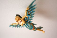 Handcrafted and painted with gold Indonesian Angel Flying Royalty Free Stock Photos