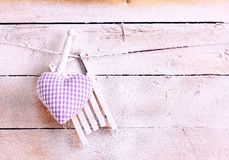 Handcrafted purple fabric heart hanging on a line stock photos