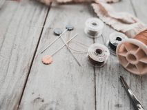 Handcrafted sewing accessories include thread bobbins, scissors, Royalty Free Stock Images