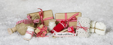 Handcrafted thinks packed with love in red white checked colors. For christmas gifts Stock Images