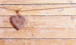 Handcrafted wooden heart hanging on a string royalty free stock image