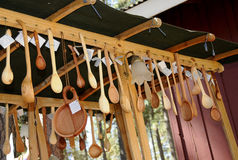 Handcrafted Wooden Spoons. Custom Handcrafted  Spoons and Bowl Hanging on Vendor's Cart at Celtic Renaissance Festival Faire Stock Photography