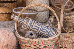 Handcrafts Covering Glass Bottles Of Rattan Weave Royalty Free Stock Photos