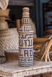 Handcrafts covering glass bottles of rattan weave Royalty Free Stock Photo