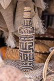 Handcrafts covering glass bottles of rattan weave Royalty Free Stock Photography