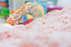 Handcrafts crochet and a small hat in vintage style Royalty Free Stock Photo