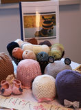 Handcrafts crochet and sweet hats for childrems. Exhibition of objects crocheted Stock Photography