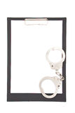Handcuff and clipboard Royalty Free Stock Photo