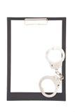 Handcuff en klembord Royalty-vrije Stock Foto