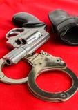 Handcuff and gun Stock Photography