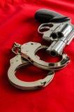 Handcuff and gun Royalty Free Stock Image