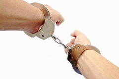 Handcuff in a hand Royalty Free Stock Photos