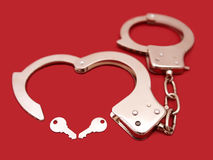 Handcuff heart-shape Stock Photo