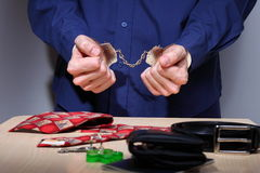 Handcuffed. Businessman with handcuffs, stripped of personal items during arrest Royalty Free Stock Photos