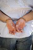 Handcuffed. Man hands cuffed behind his back Royalty Free Stock Images