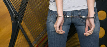 Handcuffed Arms Restrained From the Back Side Royalty Free Stock Photo