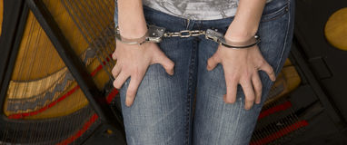 Female Wrists Waist Handcuffed Locked Restrained. A female is hancuffed from the front Royalty Free Stock Images