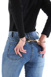 Handcuffed. Young woman with handcuffs isolated on white stock images