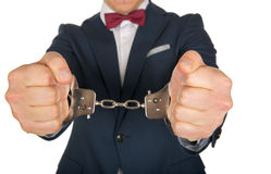 Handcuffed businessman. Close up photo of a handcuffed businessman hands Stock Images