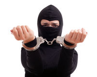Handcuffed female thief Stock Photo