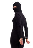 Handcuffed female thief in black balaclava Stock Image