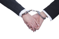 Handcuffed hands Stock Photography