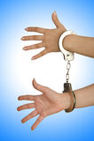 Handcuffed hands Stock Images