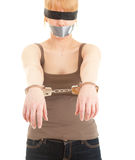 Handcuffed kidnapped young woman, hostage Royalty Free Stock Images
